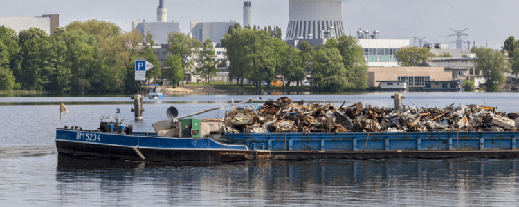 ship waste collection being carried out on water